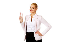 Happy business woman showing victory sign Royalty Free Stock Photography