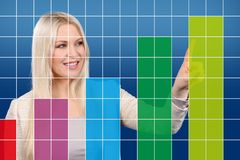Happy business woman shows a graphic Royalty Free Stock Image