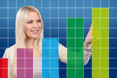 Happy business woman shows a graphic Stock Photo
