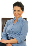 Happy business woman sit on chair Stock Photos