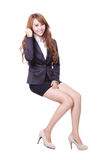 Happy business woman sitting Royalty Free Stock Photo