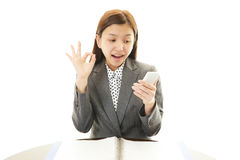 Happy business woman with smartphone Stock Images