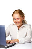 A Happy business woman smiling. A Happy successful business woman smiling while working on laptop Royalty Free Stock Photo