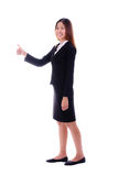 Happy business woman smiling and giving thumbs up on white backg Royalty Free Stock Photography
