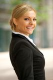 Happy business woman smiling outdoors Royalty Free Stock Photos
