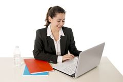 Happy business woman smiling working on her laptop Stock Photography