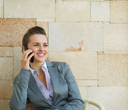 Happy business woman speaking mobile phone Stock Photos