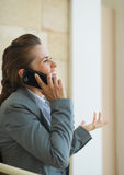 Happy business woman speaking mobile phone Stock Photo