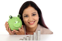 Happy business woman with stack of coins Stock Photography