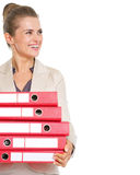 Happy business woman with stack of folders looking on copy space Royalty Free Stock Photography