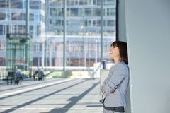 Happy business woman standing alone Stock Photo