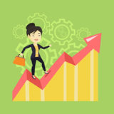 Happy business woman standing on profit chart. Stock Photos