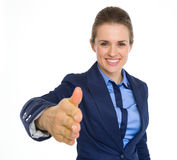 Happy business woman stretching hand for handshake Royalty Free Stock Photos