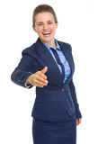 Happy business woman stretching hand for handshake Stock Photos