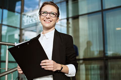 Happy Business woman, successful business lady portrait, manager holding documents. Stock Photo
