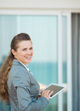 Happy business woman with tablet pc on terrace Royalty Free Stock Images