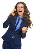 Happy business woman talking cell phone and rejoicing. High-resolution photo Stock Image