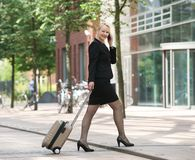Happy business woman talking on mobile phone in the city Stock Images