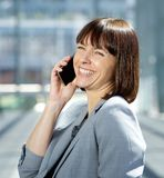 Happy business woman talking on mobile phone Royalty Free Stock Photos