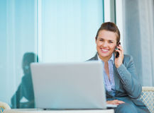 Happy business woman talking mobile phone Royalty Free Stock Photo