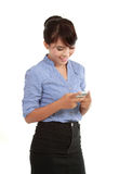 Happy business woman text messaging Royalty Free Stock Image