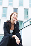 Happy business woman thinking Royalty Free Stock Photo