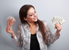 Happy business woman thinking that currency to choose, dollars o Royalty Free Stock Photo