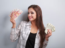Happy business woman thinking that currency to choose, dollars o Royalty Free Stock Photography