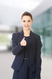 Happy business woman with thumb up Stock Images