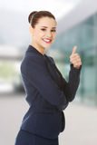 Happy business woman with thumb up Stock Photos
