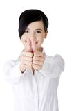 Happy business woman with thumbs up gesture Royalty Free Stock Image