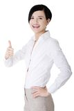 Happy business woman with thumbs up gesture Royalty Free Stock Photo