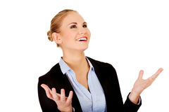 Happy business woman trying to catch something Royalty Free Stock Photo