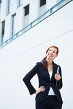 Happy business woman and university Stock Images