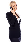 Happy business woman using cell phone Royalty Free Stock Photos