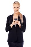 Happy business woman using cell phone Stock Photos