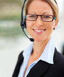 Happy business woman using headset Royalty Free Stock Photo