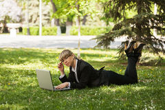 Happy business woman using laptop in a city park Royalty Free Stock Photo