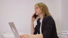 Happy business woman using mobile phone for business conversation in office. Happy business woman using mobile phone for business conversation in modern office stock video footage