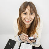 Happy business woman using a smart phone and digital tablet Stock Photography