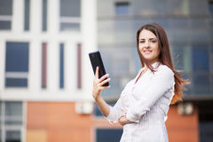 Happy business woman. Using a tablet computer Stock Photography