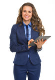 Happy business woman using tablet pc Royalty Free Stock Photography