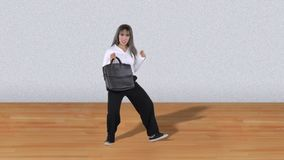 Woman walks with briefcase and dancing. Happy business woman walks with briefcase and dancing in the studio. Shot in 4k resolution stock footage