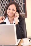 Happy business woman at work Stock Photos