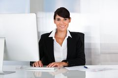 Happy business woman working on computer Stock Images