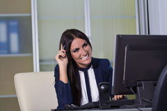 Happy business woman working on a computer Royalty Free Stock Image