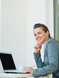 Happy business woman working on laptop Stock Photo