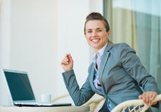 Happy business woman working on laptop Stock Photography