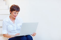 Happy business woman working on a laptop Stock Photo