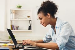Happy business woman working on laptop at office stock images